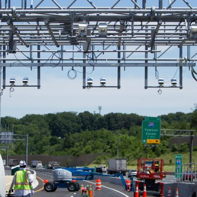 Installation of an overhead toll gantry over the future I-95 Express Toll Lanes.