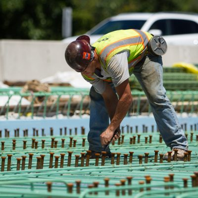 Rebar is tied together by hand before concrete can be poured.